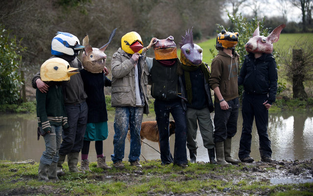Opponents against the international airport project in the French western city of Notre-Dame-des-Landes pose for journalists with animal masks made to wear at a demonstration planned in three days in Nantes, on February 19, 2014, in Notre-Dame-des-Landes. The project was signed in 2010 and the international airport is supposed to open in 2017 near the city of Nantes. (Photo by Jean-Sebastien Evrard/AFP Photo)