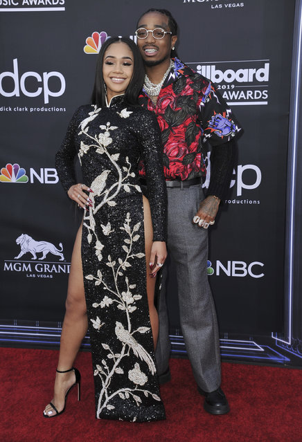 Saweetie, left, and Quavo arrive at the Billboard Music Awards on Wednesday, May 1, 2019, at the MGM Grand Garden Arena in Las Vegas. (Photo by Richard Shotwell/Invision/AP Photo)
