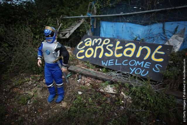 Patrick Sheridan, aged seven, poses for a photograph in a Power Rangers' outfit at the entrance to Camp Constant at Dale Farm travellers camp