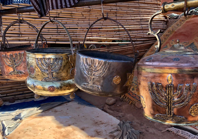 This January 16, 2019, photo shows cooking pots adorned with menorahs in an outdoor stall near Ksar of Ait-Ben-Haddou in southern Morocco. The North African kingdom once had a thriving Jewish population. Jews of Moroccan descent return often in heritage tours. (Photo by Leanne Italie via AP Photo)