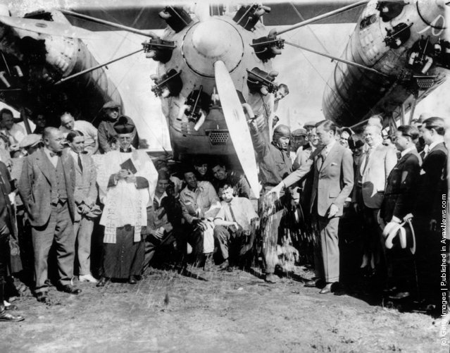The Mayor of New York, James J. Walker, christens Captain Rene Fonck's mammoth Sikorsky at Roosevelt Field, New York