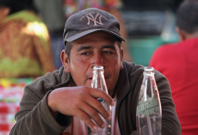 Former undocumented immigrant Pedro de leon Caballeros finishes a meal at an outdoor market February 11, 2017 in Almolonga, Guatemala. He said that he was deported from the U.S. to Guatemala after working for three years in Houston. (Photo by John Moore/Getty Images)