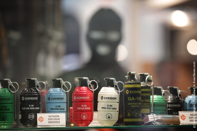 Gas cannisters and explosive grenades are displayed at the Defence and Security Exhibition