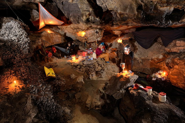 The underground camp in Sang Wang Dong is a cosy and warm place to stay. Hot food and drink recharge weary and tired explorers before taking a few hours sleep in either suspended hammocks or on roll mats on the floor. (Photo by Robbie Shone/Caters News/ImagineChina)