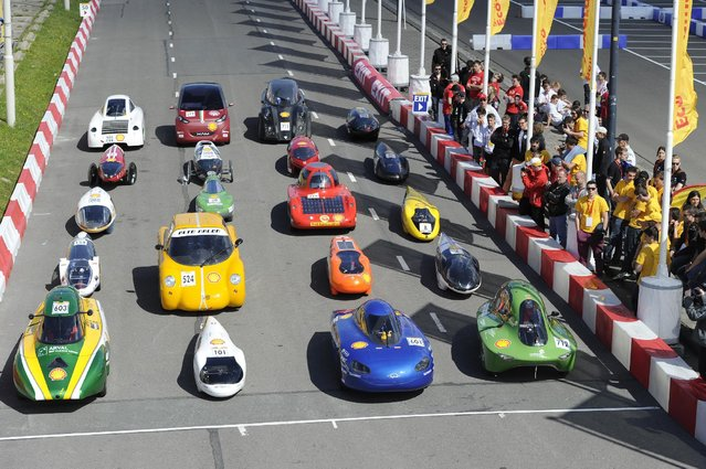 Cars line up for the group photo during the second day of practise at the Shell Eco-marathon Europe 2015 on Thursday, May 21, 2015, in Rotterdam, the Netherlands. (Photo by Patrick Post/AP Images for Shell)