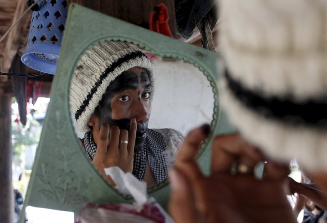 "A villager paints his face during the annual ""Lok Ta Pring Ka-Ek"" religious ceremony, on the outskirts of Phnom Penh May 22, 2015. (Photo by Samrang Pring/Reuters)"