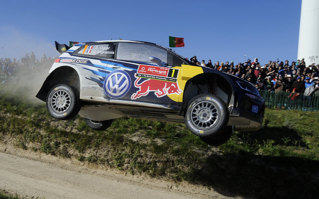 Volkswagen Motorsport driver Sebastien Ogier and his co-driver Julien Ingrassia, both from France, steer their Volkswagen Polo R WRC during the Portugal FIA World Rally Championship Sunday, May 24, 2015 in Lameirinha, Fafe, Portugal. (Photo by Paulo Duarte/AP Photo)