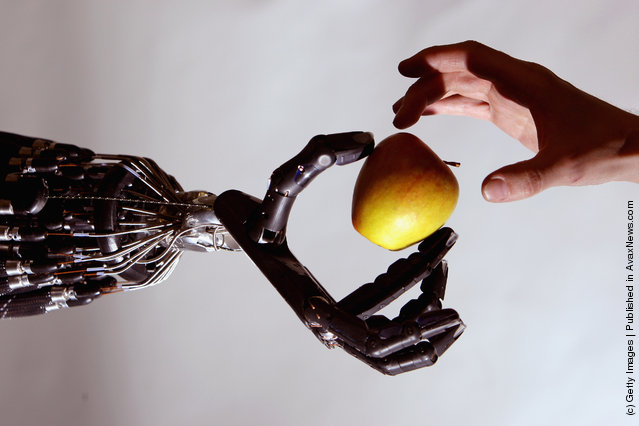 The Shadow Robot company's dextrous hand robot holds an Apple at the Streetwise Robots event held at the Science Museum's Dana Centre