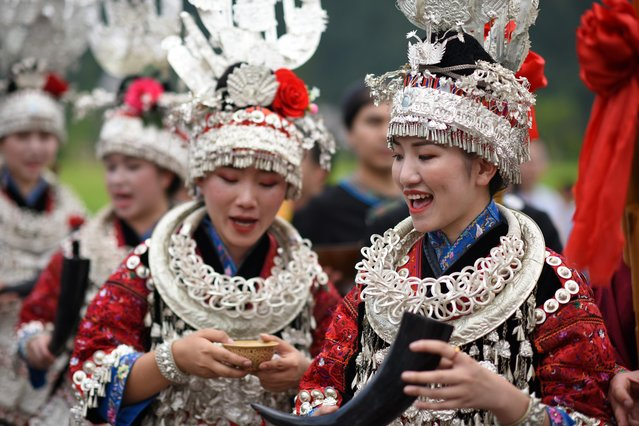 Women of Miao ethnic group are seen during a dragon canoe festival in Shidong Town, in Guizhou, China on June 27, 2019. Local Miao people celebrated the annual festival in the town Thursday. (Photo by Yang Wenbin/The Times)