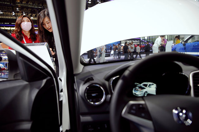 Visitors check a Changan vehicle at the company's booth during the Auto China 2016 show in Beijing, China April 25, 2016. (Photo by Damir Sagolj/Reuters)