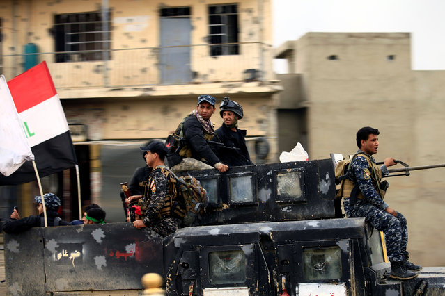 Members of the Counter Terrorism Service (CTS) sit in a military vehicle during a battle between Iraqi forces and Islamic State militants, in the city of Mosul, Iraq March 15, 2017. (Photo by Thaier Al-Sudani/Reuters)