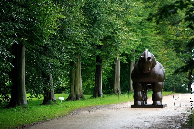 A sculpture titled Horse by Fernando Botero stands in the gardens of Chatsworth House