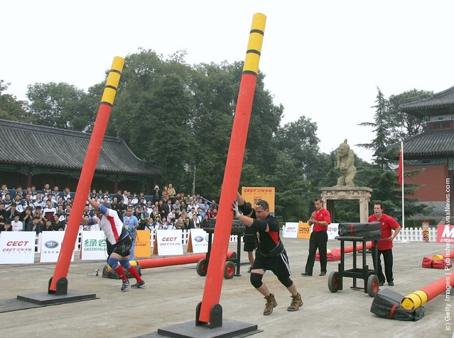 Contestants lift up poles during a match of the 2005 World's Strongest Man Competition at Wuhou Temple