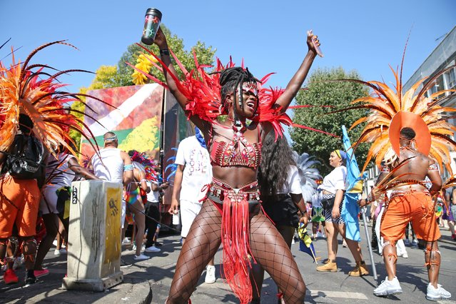 People gather in costume to present their floats to the judges on the last day of the Notting Hill carnival on August 26, 2019. Many of the costumes are made by the band members. An estimated 1 million hours go into making all of the costumes for the event that is watched by thousands of people. (Photo by Splash News and Pictures)