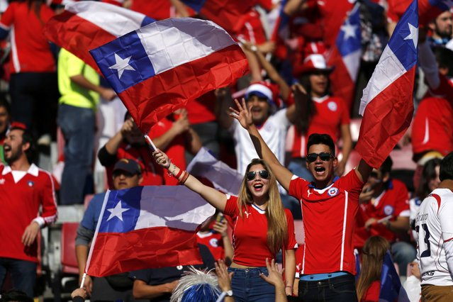Chile fans cheer ahead of the team's Copa America 2015 final soccer match against Argentina at the National Stadium in Santiago, Chile, July 4, 2015. (Photo by Marcos Brindicci/Reuters)