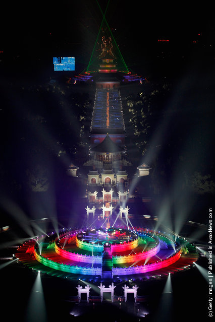 The Temple of Heaven (The Qi Nian Temple) is illuminated as Beijing celebrates the New Year's Eve at the Temple of Heaven Park