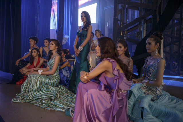 Participants wait backstage as a contestant performs. (Photo by Athit Perawongmetha/Reuters)