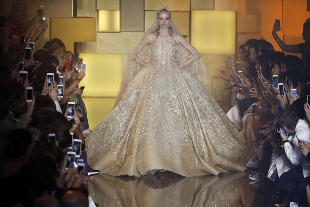A model presents a wedding dress creation by Lebanese designer Elie Saab as part of his Haute Couture Fall Winter 2015/2016 fashion show in Paris, France, July 8, 2015. (Photo by Charles Platiau/Reuters)