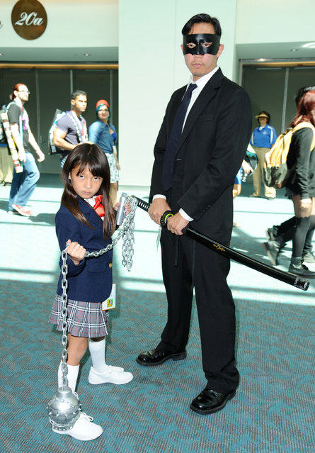 "Fans dress as characters from ""Kill Bill: Vol. 1"" on day 1 of Comic-Con International on Thursday, July 9, 2015, in San Diego, Calif. (Photo by Richard Shotwell/Invision/AP Photo)"