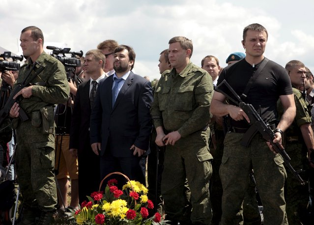 Head of the self-proclaimed Donetsk People's Republic Alexander Zakharchenko (2nd R, front) and senior official Denis Pushilin (3rd R, front) attend a commemoration ceremony at the site of the Malaysia Airlines flight MH17 plane crash near the village of Hrabove in Donetsk region, Ukraine, July 17, 2015. (Photo by Kazbek Basaev/Reuters)