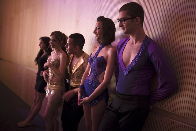 Participants watch from backstage during a Latin dance competition in Tel Aviv, Israel July 18, 2015. (Photo by Amir Cohen/Reuters)