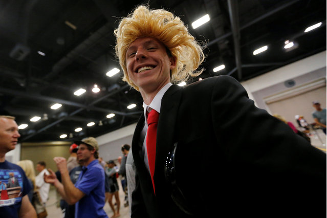 A supporter of Republican U.S. presidential candidate Donald Trump dresses in a Trump costume at a rally with supporters in Albuquerque, New Mexico, U.S., May 24, 2016. (Photo by Jonathan Ernst/Reuters)