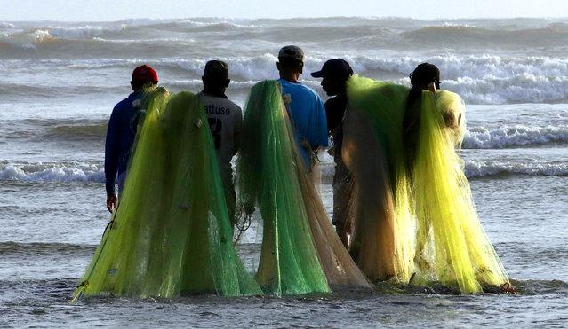 Fishermen prepare to fish at the beach in Karachi, Pakistan, 17 September 2019. (Photo by Rehan Khan/EPA/EFE)