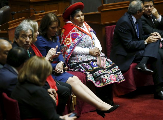 Hilaria Supa (R), representative of the Andean Parliament, dressed in traditional clothes, sits next to Paola Bustamante, Minister of Development and Social Inclusion, as they wait for the start of Independence Day celebrations at Congress in Lima, July 28, 2015. (Photo by Mariana Bazo/Reuters)