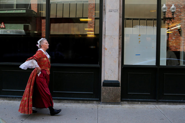 A tour guide in period clothing walks down street in downtown Boston, Massachusetts, U.S., May 10, 2016. (Photo by Brian Snyder/Reuters)