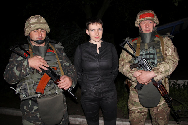 Ukrainian pilot and MP Nadiya Savchenko poses with Ukrainian servicemen during a visit to the area controlled by Ukrainian forces outside Slaviansk, Ukraine, June 5, 2016. (Photo by Vad Smith/Reuters)