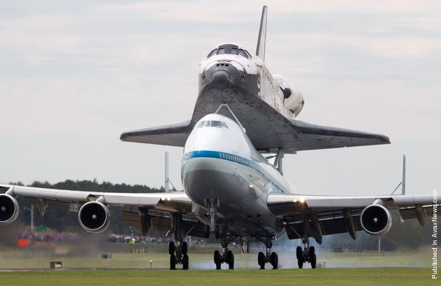 Discovery and the shuttle carrier aircraft land at Dulles International Airport in Chantilly, Virginia, on Tuesday, April 17, 2012
