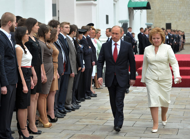 Russian President Vladimir Putin and his wife Lyudmila walk in Cathedral Square after his inauguration in the Kremlin in Moscow, Monday, May 7, 2012. Vladimir Putin has been sworn in as Russia's president for a third term after four years as prime minister. (Photo by Alexei Nikolsky/AP Photo/RIA-Novosti/Government Press Service)