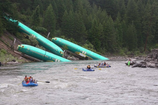 Three Boeing 737 fuselages lie on an embankment on the Clark Fork River after a BNSF Railway Co train derailed Thursday near Rivulet, Montana in this picture taken July 4, 2014. A train derailment in Montana this week damaged a shipment of jetliner fuselages and other large parts on its way to Boeing Co factories in Washington state from Spirit Aerosystems, Boeing said on Saturday. (Photo by Kyle Massick/Reuters)
