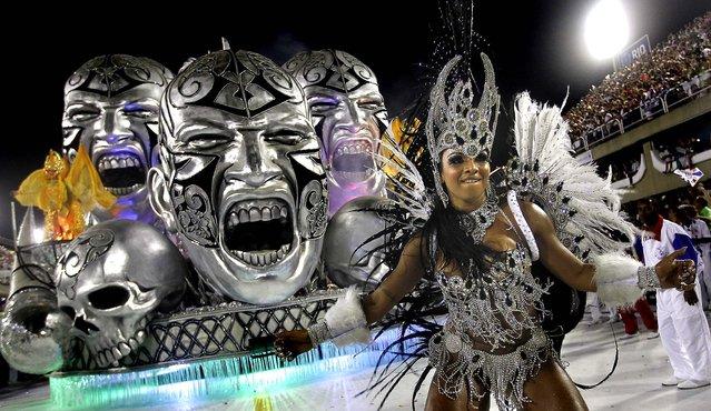 A dancer from the Uniao da Ilha samba school performs at the Sambadrome in Rio de Janeiro