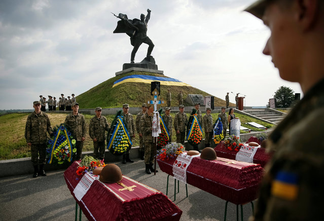 Ukrainian servicemen take part in a reburial ceremony of remains of Red Army soldiers killed in World War Two in Baryshiv, Ukraine June 22, 2016. (Photo by Gleb Garanich/Reuters)