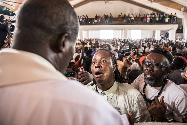 Catholic faithful gather at a church in Port-au-Prince before a silent and non-violent march against the Haitian government on October 22, 2019. Thousands of Catholics demanding the resignation of Haiti's president marched through the capital Tuesday, becoming the latest group to join an outcry against him. They gathered outside one of the main churches in Port-au-Prince and denounced President Jovenel Moise as corrupt and incompetent. (Photo by Valerie Baeriswyl/AFP Photo)