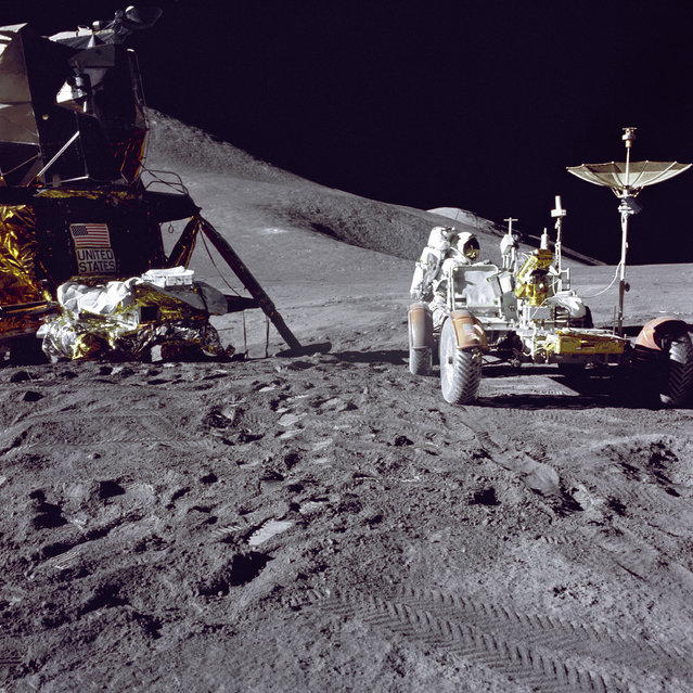 "Apollo 15 Lunar Module pilot James B. Irwin loads-up the ""Rover"", Lunar Roving Vehicle (LRV) with tools and equipment in preparation for the first lunar extravehicular activity (EVA-1) at the Hadley-Apennine landing site. A portion of the Lunar Module (LM) ""Falcon"" is on the left. The undeployed Laser Ranging Retro-Reflector (LR-3) lies atop the LM's Modular Equipment Stowage Assembly (MESA). This view is looking slightly West of South. Hadley Delta and the Apennine Front are in the background to the left. (Photo by NASA)"