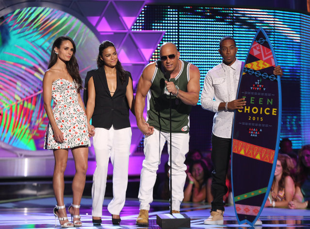"Jordana Brewster, from left, Michelle Rodriguez, Vin Diesel and Ludacris of ""Furious 7"" accept the choice movie: action/adventure award at the Teen Choice Awards at the Galen Center on Sunday, August 16, 2015, in Los Angeles. (Photo by Matt Sayles/Invision/AP Photo)"