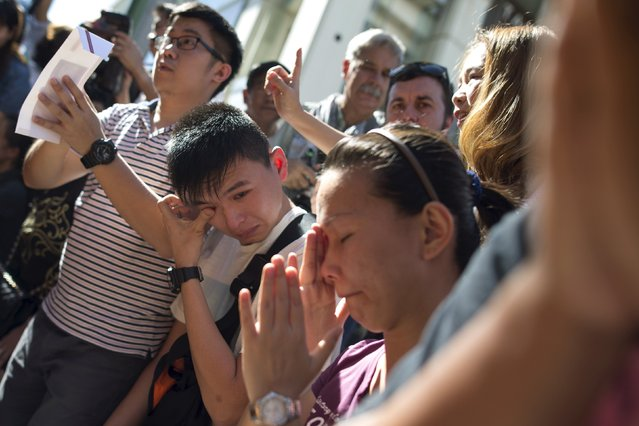 Family members of Malaysians victims weep during a Buddhist ceremony at the Erawan shrine, the site of Monday's deadly blast, in central Bangkok, Thailand, August 19, 2015. (Photo by Athit Perawongmetha/Reuters)