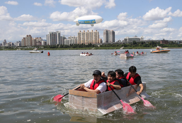 A team rows in its paper ship in an annual paper ship-riding contest on the Han River in Seoul, South Korea, 11 August 2017. (Photo by EPA/Yonhap)