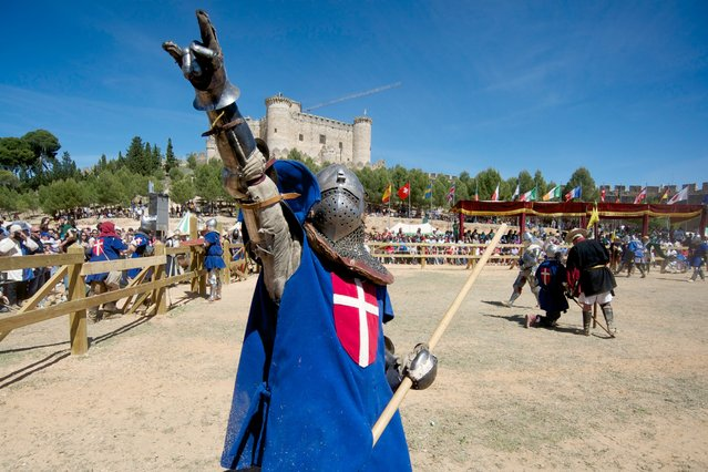 A Knight of Denmark celebrates the win during the International Medieval Combat at the castle of Belmonte, May 4, 2014, in Belmonte, Spain. (Photo by Juan Naharro Gimenez/Getty Images)