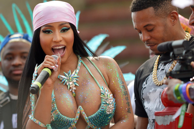 Nicki Minaj shows off to the crowd on top of a music truck during the Trinidad and Tobago Carnival in Port of Spain, Trinidad and Tobago, 26 February 2020. Minaj apologized on 26 February for her husband's behavior after a video showing Petty pushing a well-known local artist. The man had touched Minaj to allegedly encourage her in her performance. (Photo by Dexter Phillip via MoPho for London Entertainment/Splash News and Pictures)