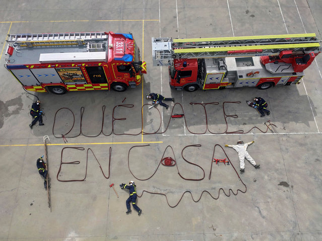 "An undated handout photo released by Aranjuez's Fire Dept. on 20 March 2020 of several firefighters as they perform an action and write the sentence ""Stay at Home"", with their fire hoses in the town of Aranjuez, outside Madrid, Spain, 20 March 2020. Spain faces the sixth day of national lockdown on 20 March in an effort to slow down the spread of the pandemic COVID-19 disease. According to the latest figures provided by the health ministry, there are at least 18,074 confirmed coronavirus infections throughout Spain, while 832 people have died so far in the Mediterranean country. (Photo by Aranjuez Fire Dept/EPA/EFE)"