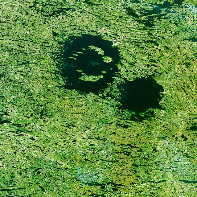 The Clearwater Lakes in Quebec are not actually two separate lakes, but a single body of water over two depressions, created by meteorite impacts over 200 million years ago. (Photo by The European Space Agency)
