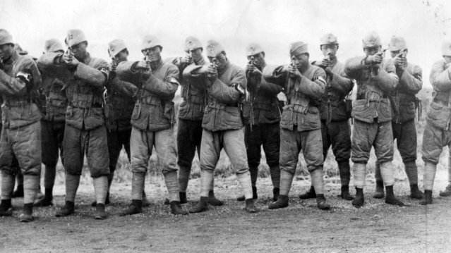 A squad of Marshal Sun's shock troops armed with Mauser pistols during training at Shanghai during civil war in China, 1927.