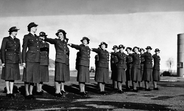 These smart uniformed young women are members of the Women's Auxiliary Air Force in New Zealand. They are engaged in all the essential branches of Women's war work, including the driving and maintenance of vehicles, hospital duties, clerical work and cooking. The efficiency in drilling of the W.A.A.F., are shown on the parade ground at Rongota aerodrome, Wellington, New Zealand, on September 2, 1941. (Photo by AP Photo)