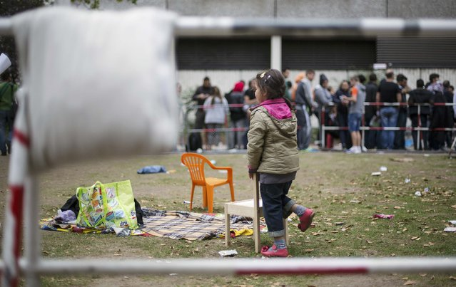 Migrants wait in front of the State Office for Health and Social Affairs (LaGeSo), in Berlin, Germany, September 3, 2015. (Photo by Hannibal Hanschke/Reuters)