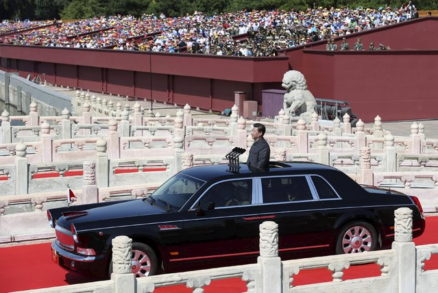 Chinese President Xi Jinping stands in a car on his way to inspect the army, at the beginning of the military parade marking the 70th anniversary of the end of World War Two, in Beijing, China, September 3, 2015. (Photo by Reuters/Stringer)