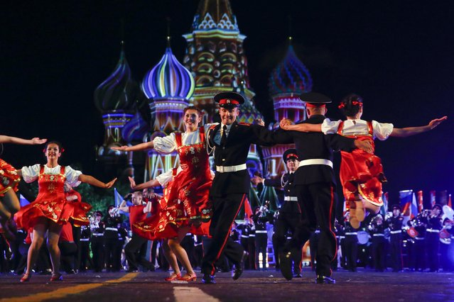 """Members of the Band of the Moscow Suvorov Military Music College from Russia perform on the first day of the International Military Music Festival """"Spasskaya Tower"""" in Red Square in Moscow, August 30, 2014. Military bands from different countries will participate in the tattoo starting from August 30 to September 7. (Photo by Maxim Zmeyev/Reuters)"""