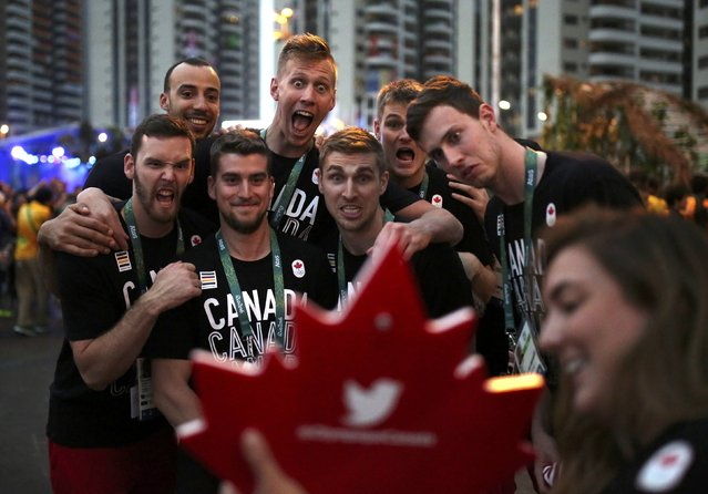Canada athletes pose for photo as they attend their welcome ceremony at the Olympic Village in Rio de Janeiro, Brazil on August 2, 2016. (Photo by Edgard Garrido/Reuters)
